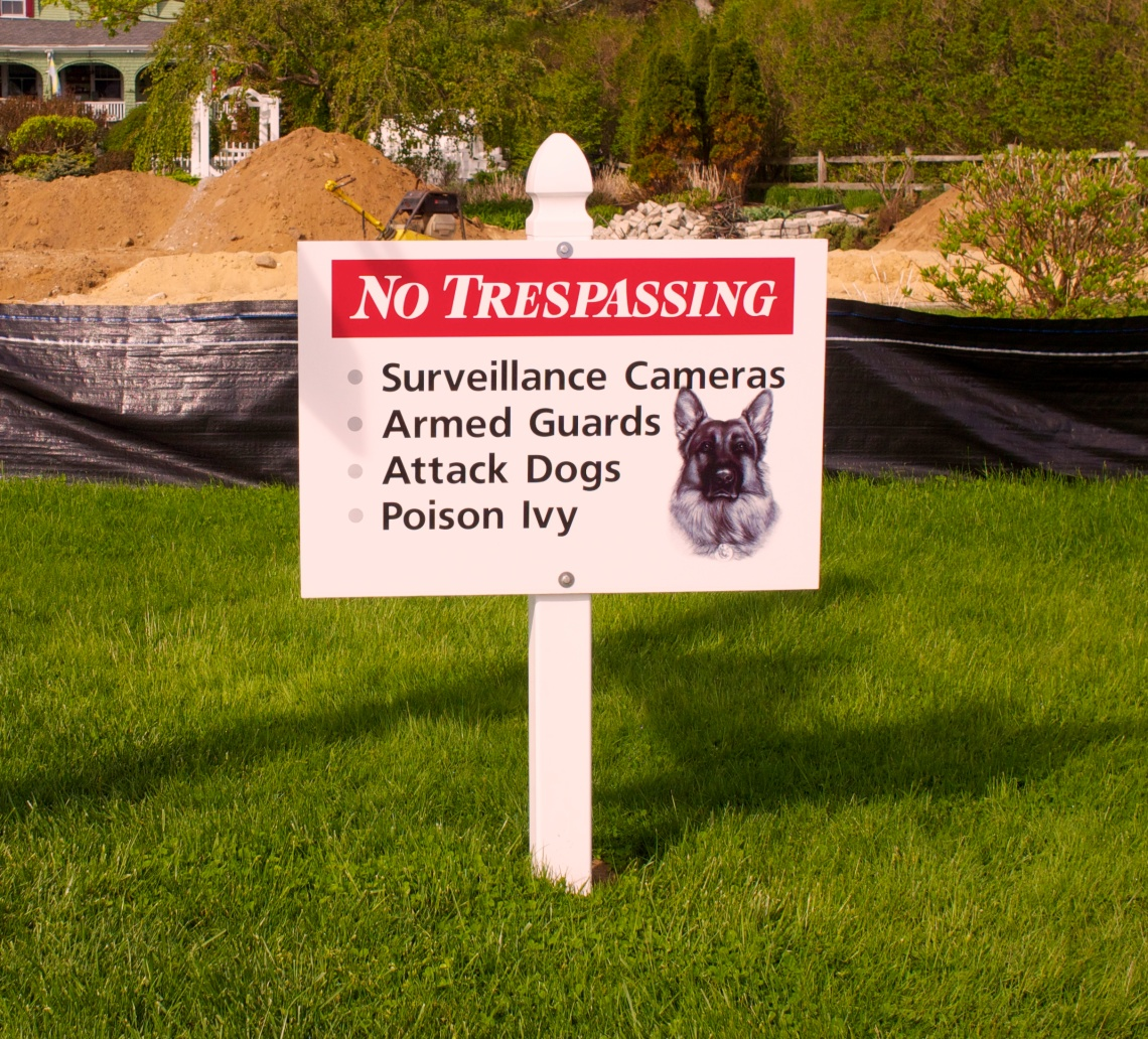 Taking a walk along Marginal Way in Oqunquit, Maine, I came upon this sign in front of a construction site for a new house. I could always throw the dog a bone, but I don't know about the poison ivy.