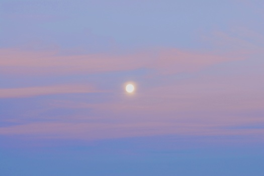 A fall moon rises over the ocean in York, Maine.