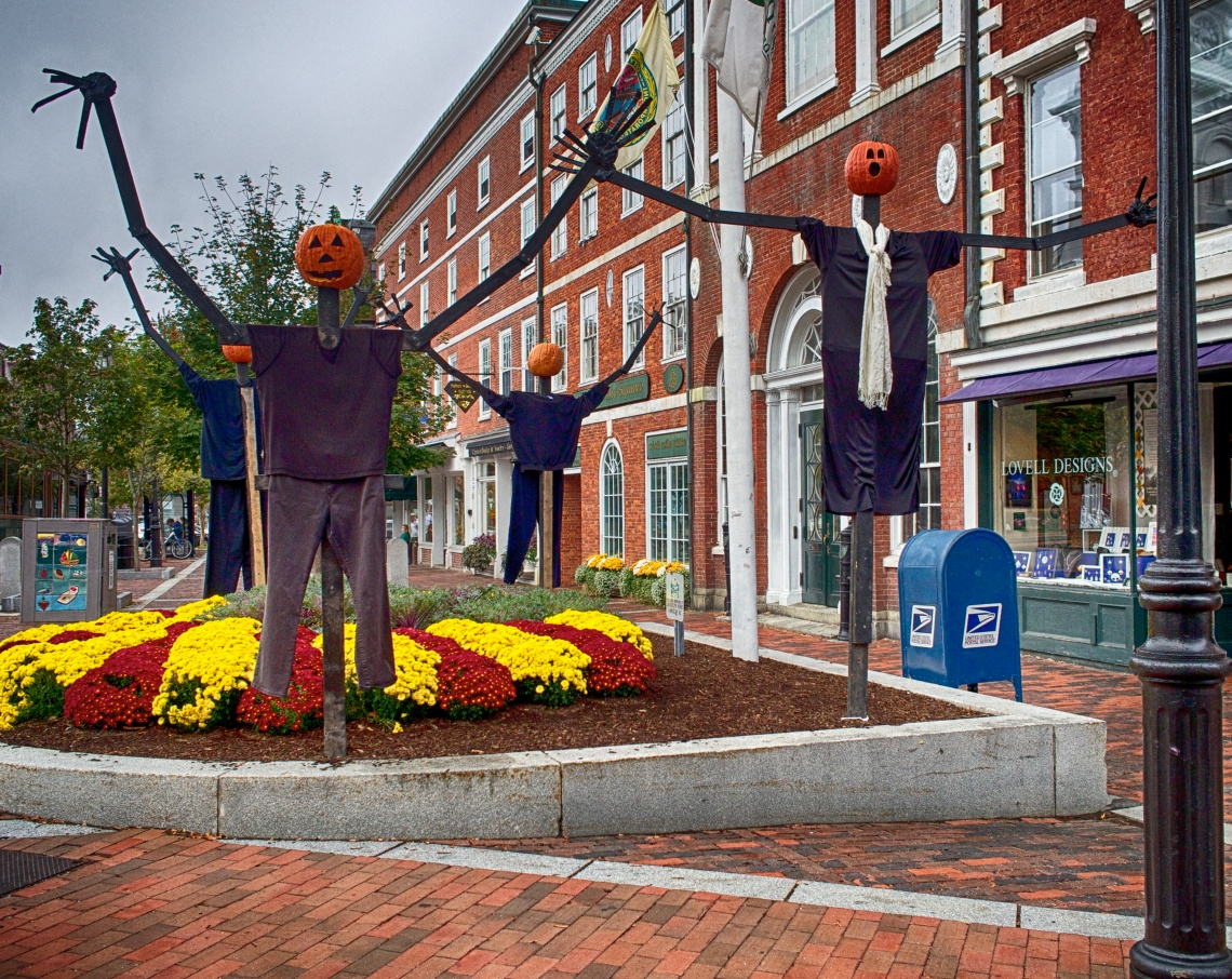 Pumpkin people stand around in Market Square in Portsmouth, NH.
